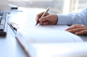 30674275 - businesswoman hands pointing at business document